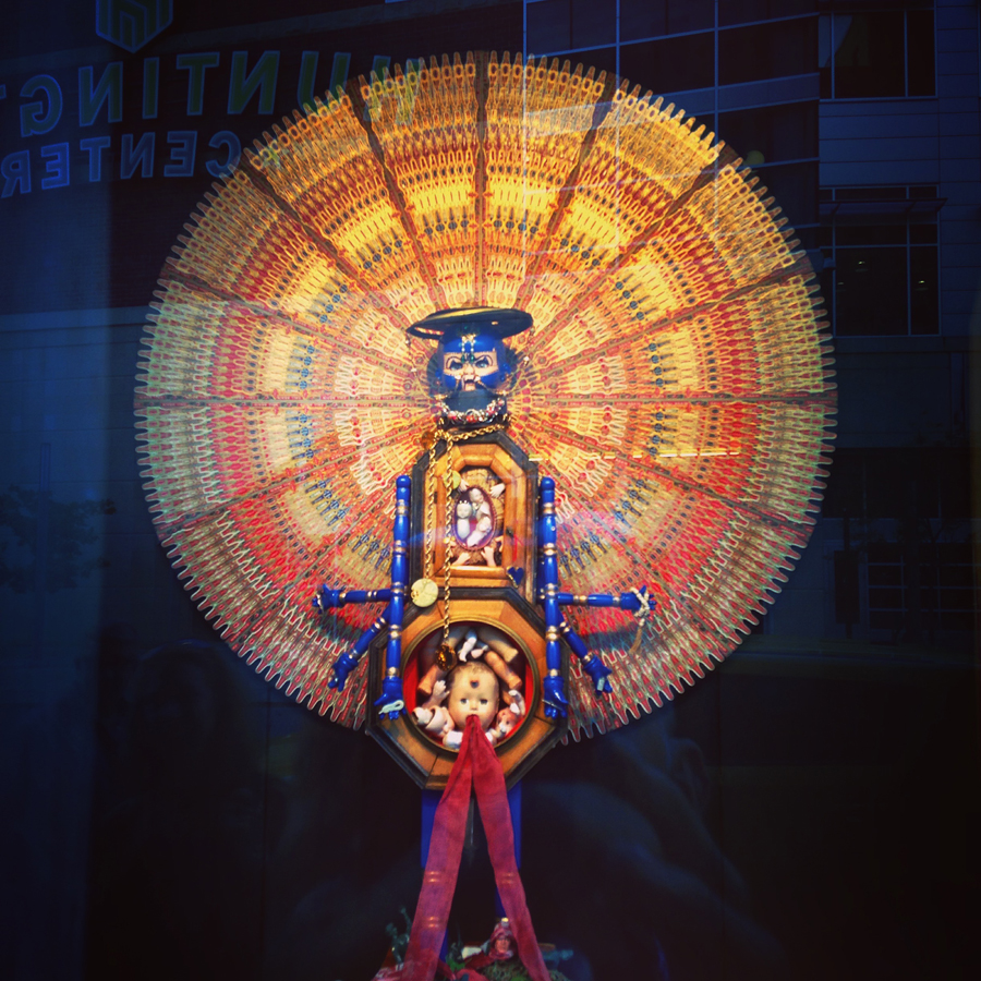 "Department store window display installed in Toledo, Ohio in an empty midcentury department store for Gallery Project\'s ""Wish List\"". \""Demon of Destruction\"" and \""48\"" Cigar Band Mandala\""  mixed media August 2015"