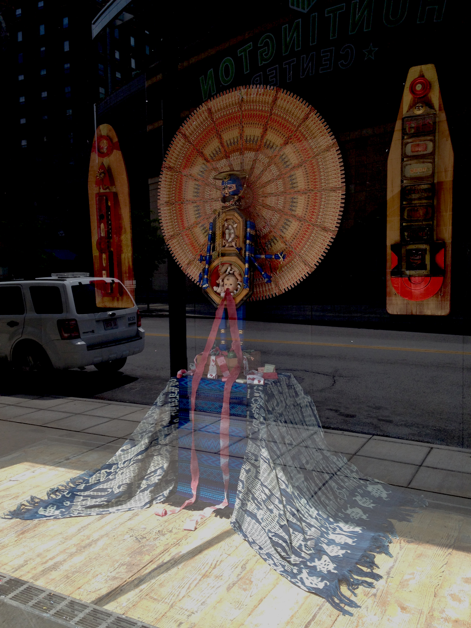 "Department store window display installed in Toledo, Ohio in an empty midcentury department store for Gallery Project\'s ""Wish List\"". \""Demon of Destruction\"", \""48\"" Cigar Band Mandala\"", 2 \""Visual Prayers \"" mixed media August 2015"
