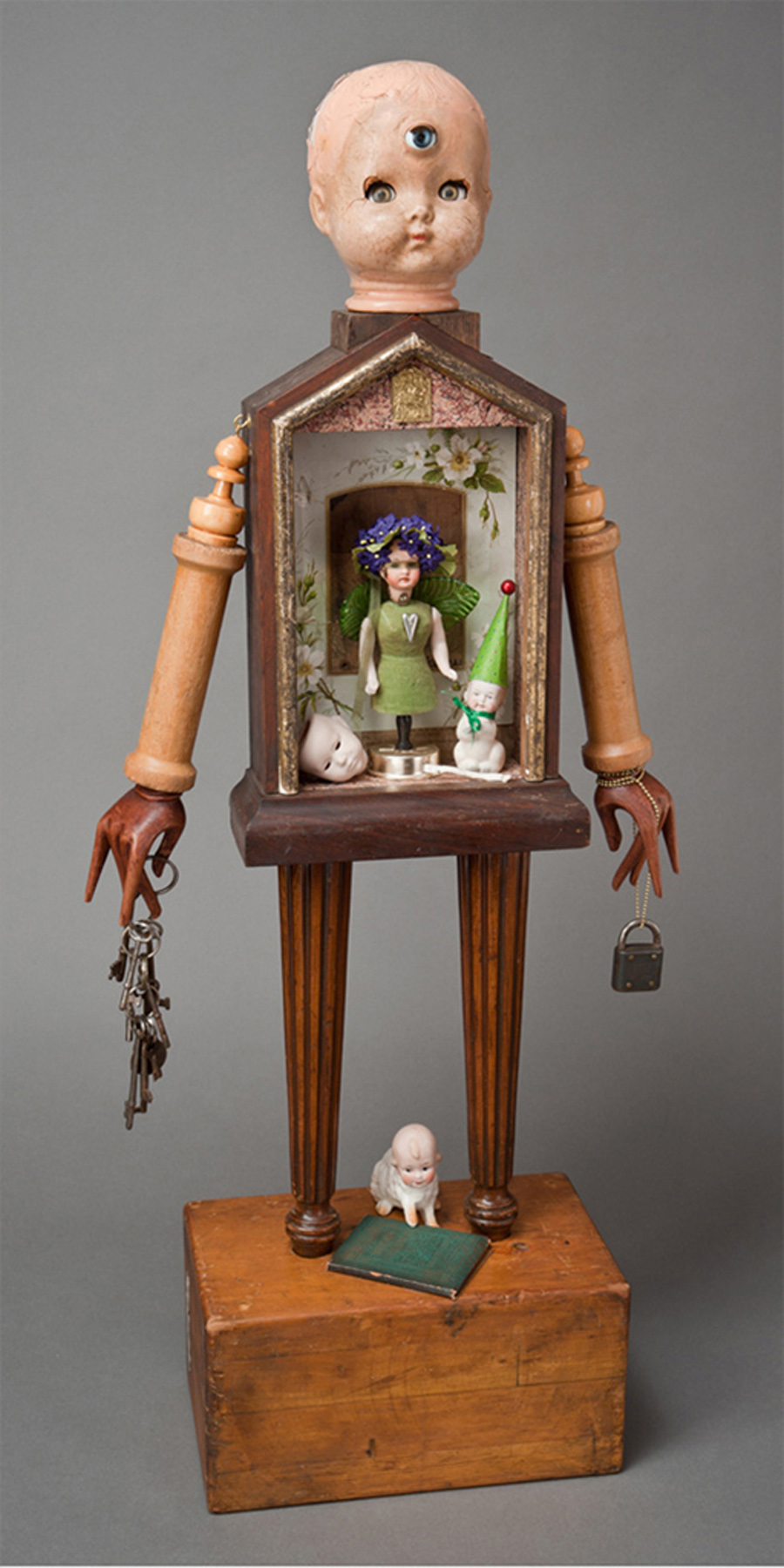 """Dream Children #1\""  mixed-media assemblage from found objects  36\""h x 16\""w x 6\""d  2011"