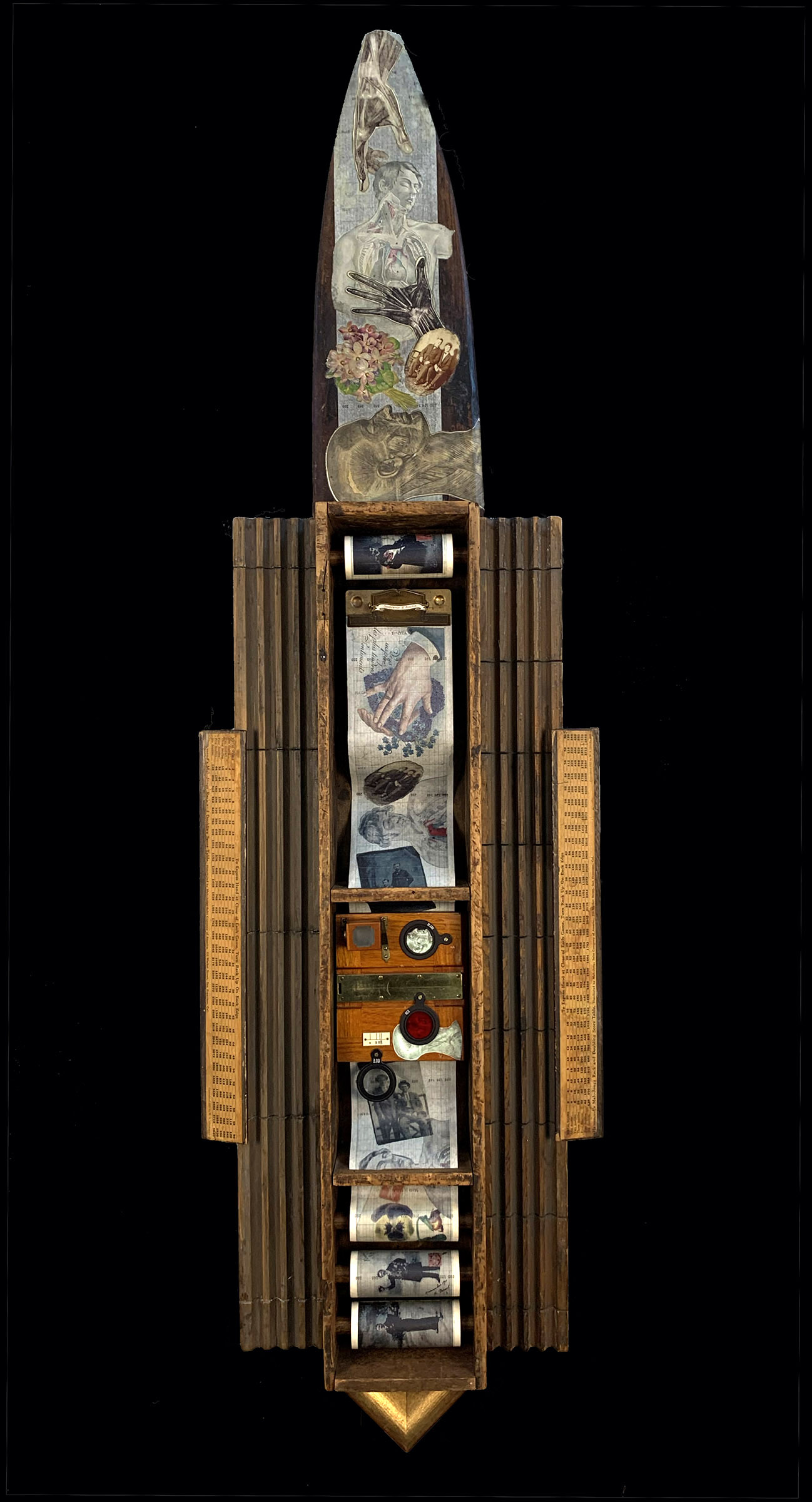 """""""As Of A Dream"""" 2011  $850.00 54""""h x 15.5""""w x 3.5""""d mixed media assemblage: wood box, chalk molds, wood pelt stretcher, wood mah-jongg trays, metal clip board, vintage wood camera parts, optical lenses, frame sample, vintage photos, digital scans, graphic paper recording rolls"""