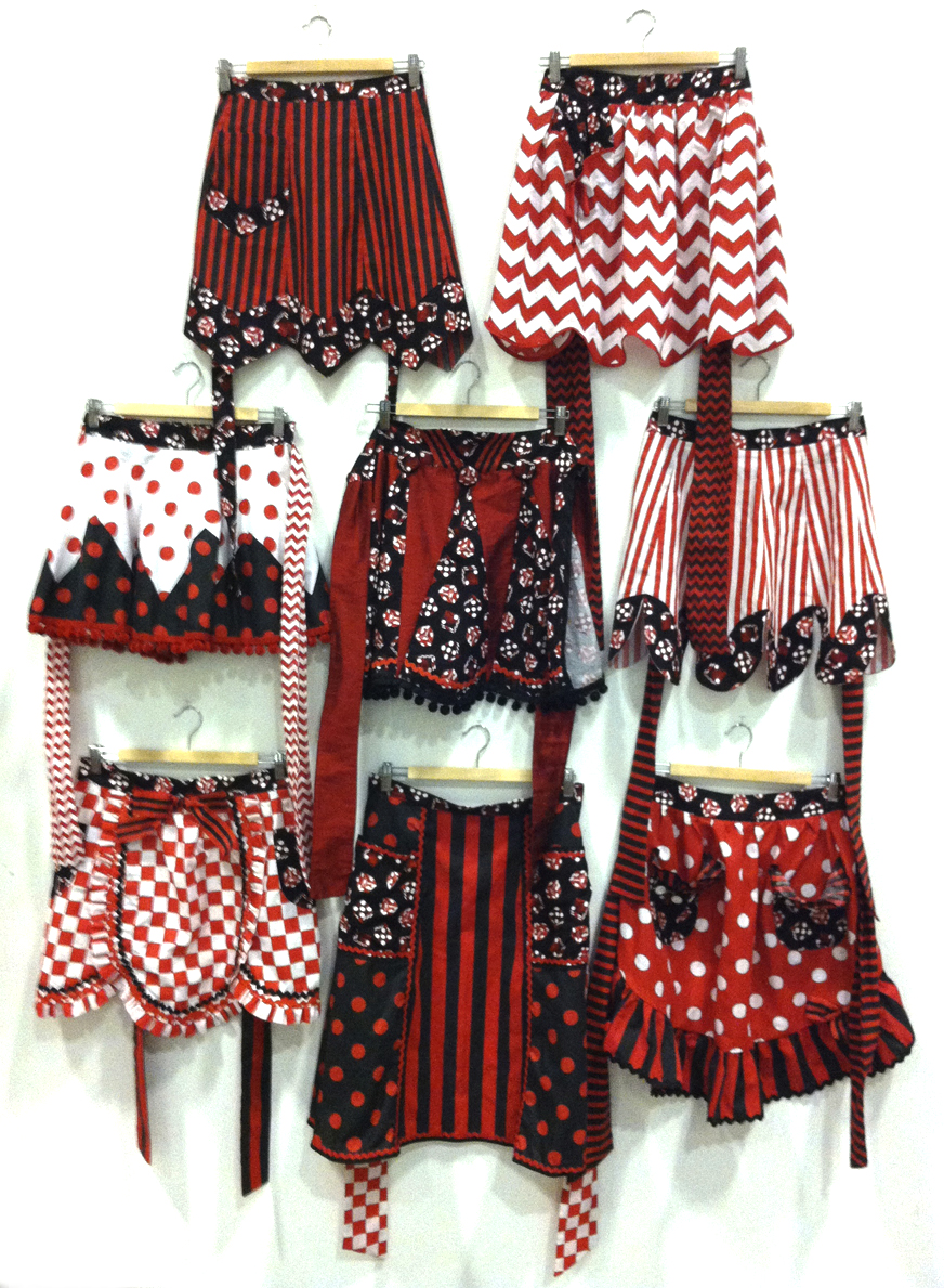 Shaman Johnny\'s Ceremonial Aprons  (2013)  red, black, & white cotton fabric, ribbon, ball fringe, rick-rack, buttons
