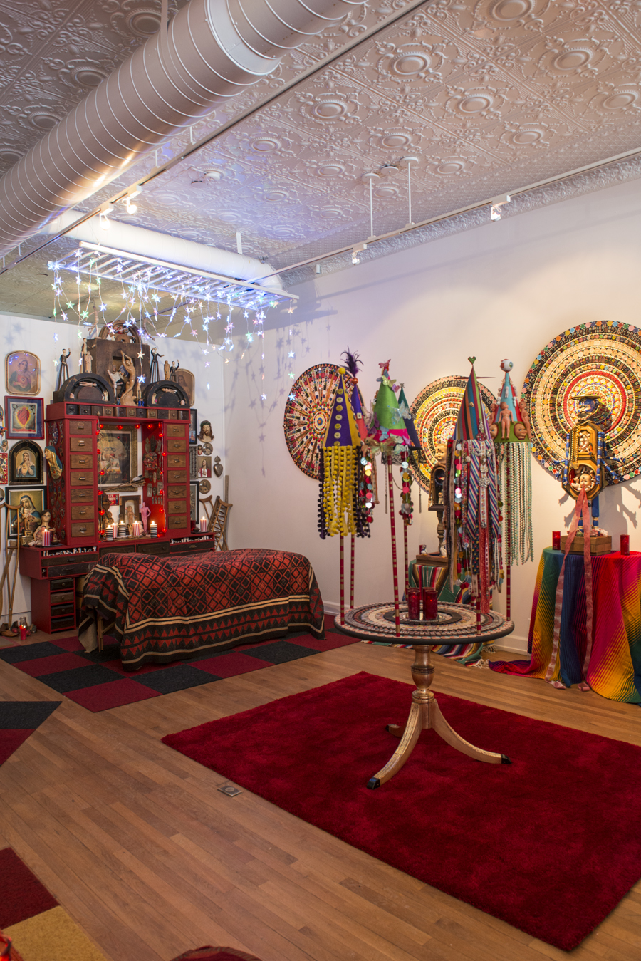 """Altar of Containment and Memory\"", mandalas and figures, and \""Table of Crowns\"" in the therapeutic bodywork area of the Sacred Backroom."