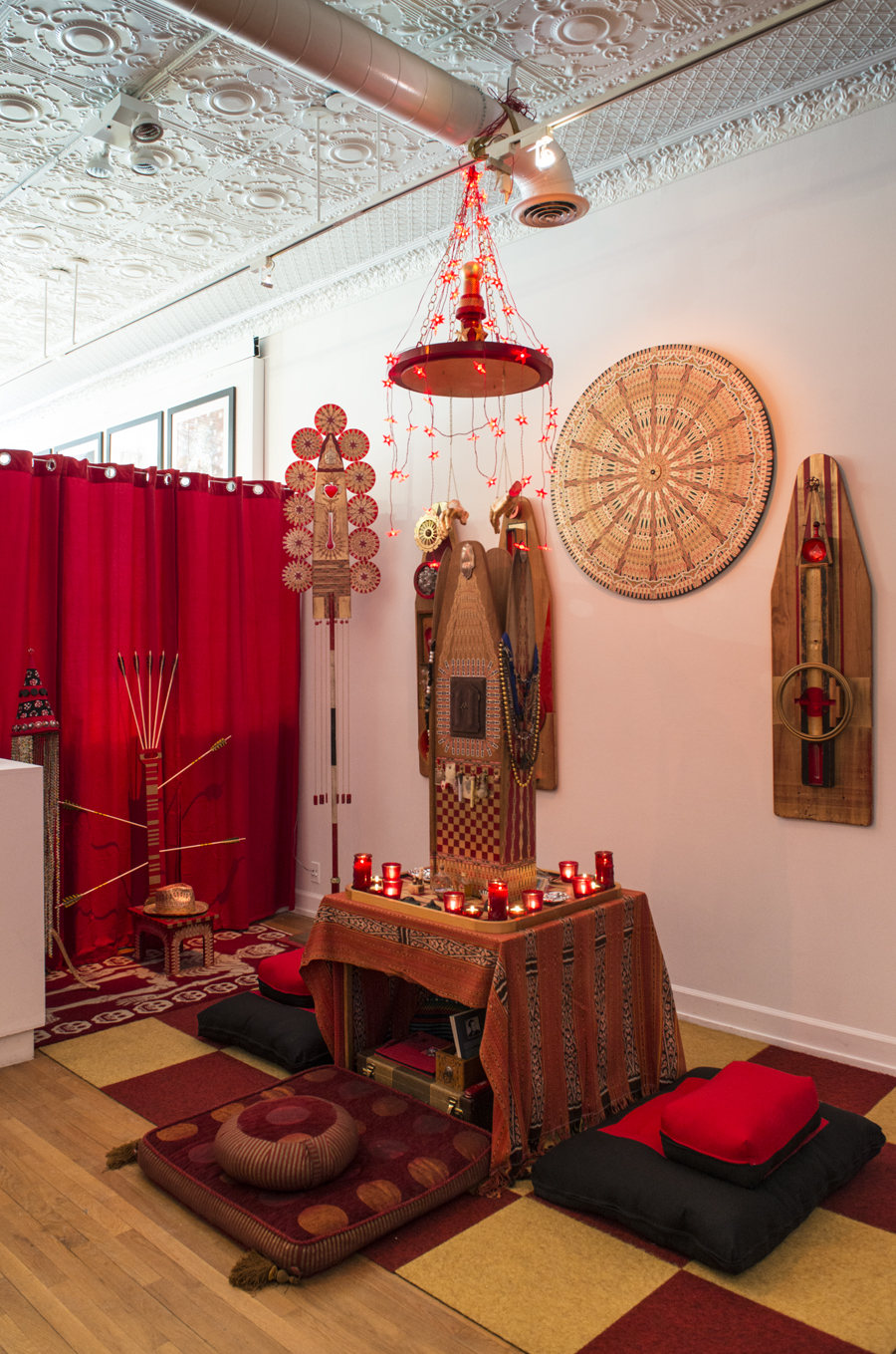 "Meditation area of Sacred Backroom at Shaman Johnny\'s Pop-Up Shop & Gallery. (L to R in back ground) ""Shaman Johnny\'s Crown\"", \""Throne of St. Sebastian\"", \""Staff of Compassion\"", \""Visual Prayers\"", and \""Halo\"". \""Reliquary of Protection\"" on table."